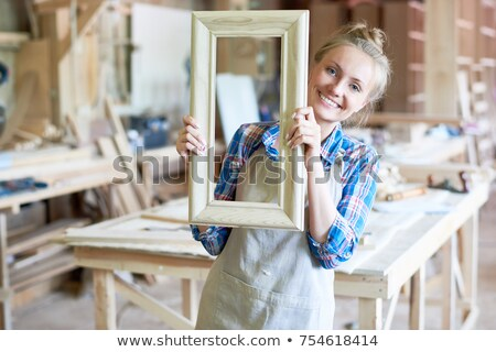 Female carpenters making wooden frame stock photo © photography33