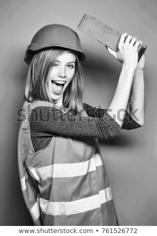 Wink from a female construction worker Stock photo © photography33