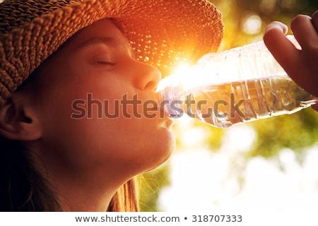 ragazza · bere · limonata · paglia · isolato - foto d'archivio © lithian