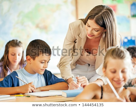 Woman helping a child with her geography homework Stock photo © photography33