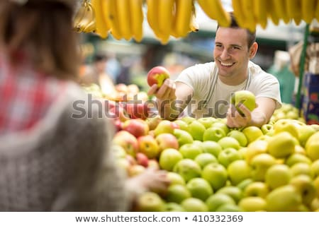 hand picking fresh organic vegetables at a street market in ista stock photo © kuzeytac
