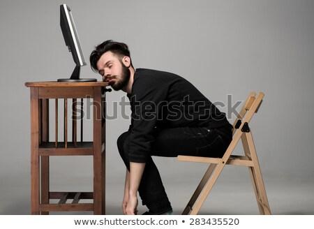 fiatalember · alszik · szék · mozi · film · férfi - stock fotó © photography33