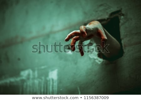 Stock photo: Bloody zombie hands