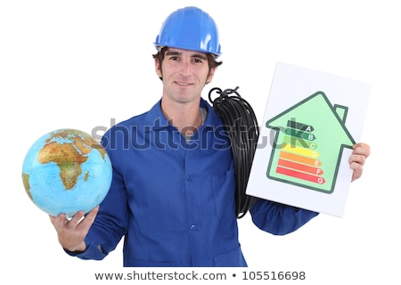 Electrician with a rating sign and a globe Stock photo © photography33
