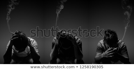 Stock photo: Portrait of the young man with a cigarette