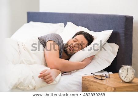 Serein homme dormir chambre maison visage Photo stock © wavebreak_media