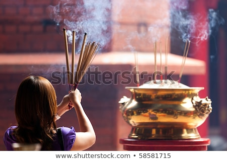 traditional incense burning in chinese temple in malaysia stock photo © travelphotography