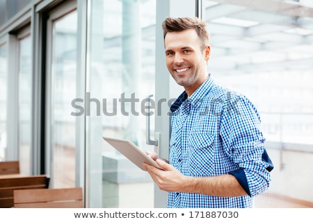 business man cheers with tablet in hand stock photo © feedough