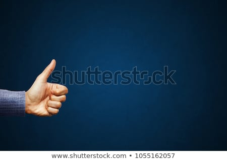 businessman shows thumbs up sign Stock photo © meinzahn