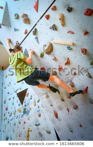 Boy Climbing up Boulder Stock photo © bigandt