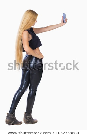 rear view of young woman in leather pants stock photo © elisanth