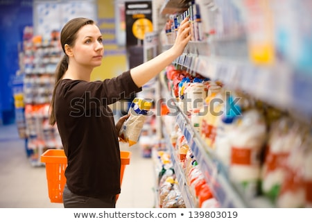 Stockfoto: Young Woman Shopping For Cereal Bulk In A Grocery Supermarket