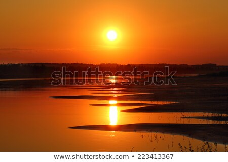 beautiful sunset with waved river sand beach Stock photo © Mikko