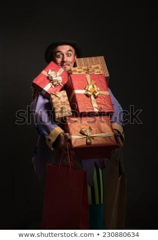 Man clown carrying Christmas gifts stock photo © HASLOO