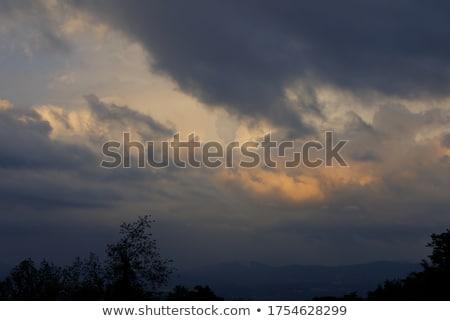 Sağanak dağlar gökyüzü ağaç bulutlar çim Stok fotoğraf © entazist