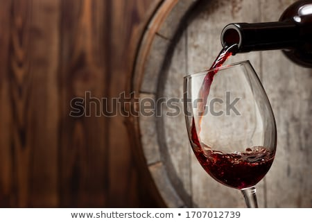 Glass of wine on the wooden background Stock photo © CaptureLight