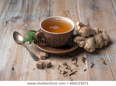 Taza té de hierbas azúcar moreno servido blanco platillo Foto stock © ozgur