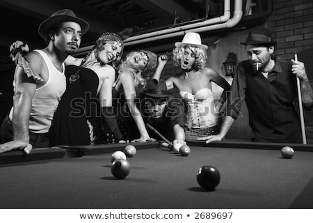 Retro woman in pool hall. Stock photo © iofoto