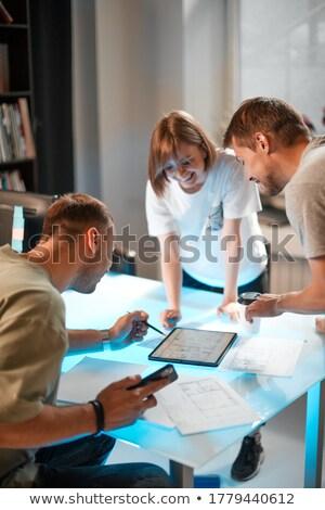 Smiling architect team brainstorming together using tablet  Stock photo © wavebreak_media