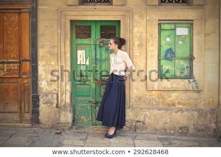 Mulher longo saia estúdio retrato mulher atraente Foto stock © filipw