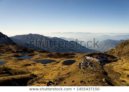 Clouds hanging over remote peaks Stock photo © wildnerdpix