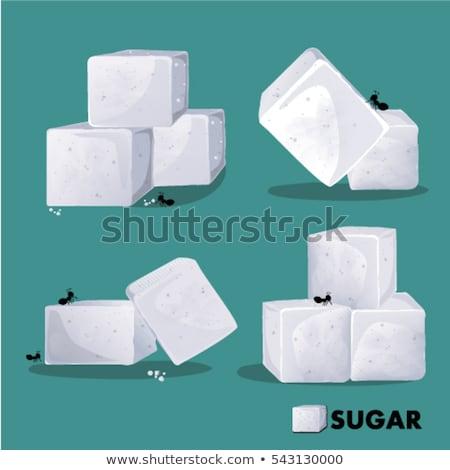 Stock photo: White sugar cubes in a box