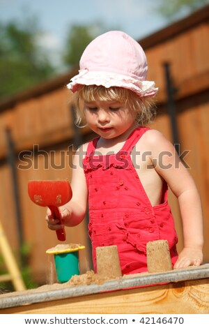 The girl plays to a sandbox.Vertical format. Stock photo © Paha_L