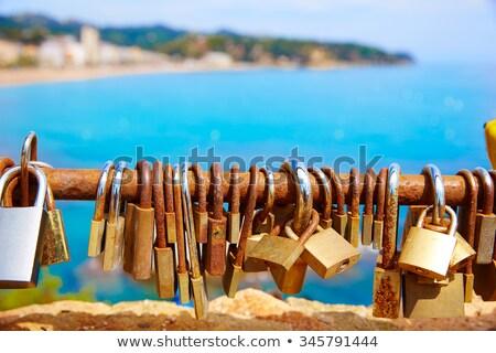 Costa Brava beach Lloret de Mar padlocks in a row Stock photo © lunamarina