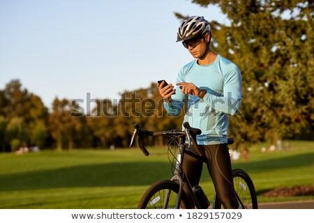 Homem ciclismo capacete bicicleta parque Foto stock © deandrobot