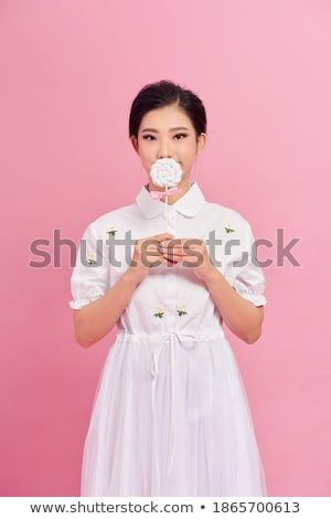 funny cute young woman covered her mouth with lollipop stock photo © deandrobot