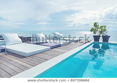 Cadeiras piscina azul recorrer Turquia Foto stock © simply