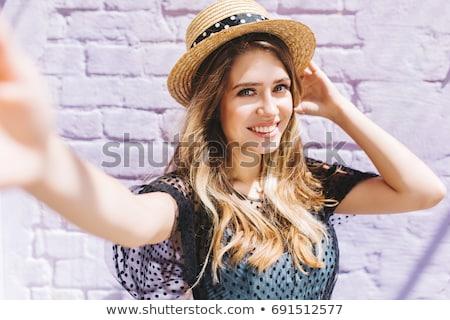 Attractive blond lady with a hollywood smile Stock photo © konradbak