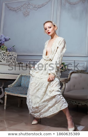 stylish elegant blonde woman in beauty rich interior, wearing black dress smiling, lifestyle people  Stock photo © iordani