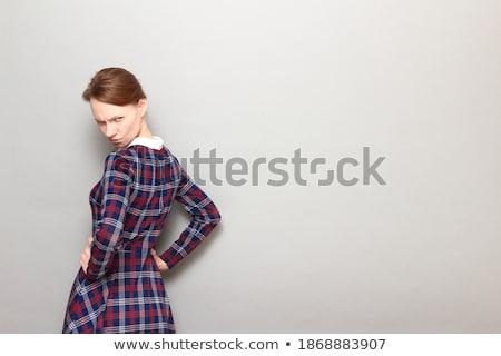 Elégedetlen nő karok csípő néz kamera Stock fotó © deandrobot