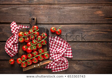 Stock photo: Fresh cherry tomatoes on twigs on wooden table, top view