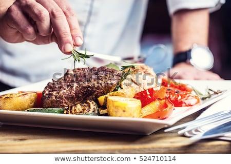 chef preparing food in the commercial kitchen stock photo © wavebreak_media