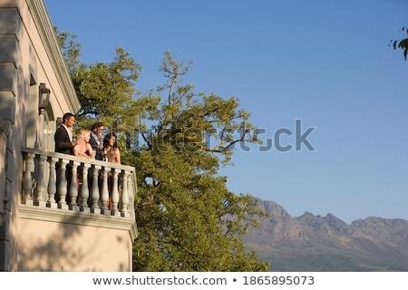 Barátok pezsgő erkély otthon nő boldog Stock fotó © wavebreak_media