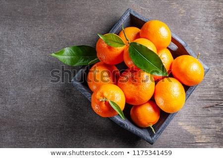 Maturo mandarino arance basket ciotola foglie Foto d'archivio © Digifoodstock