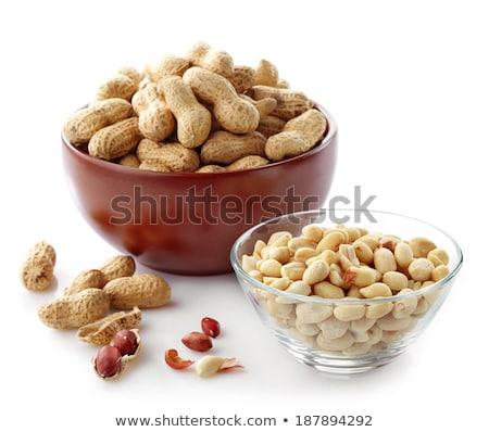 Stock photo: peeled and unpeeled peanuts