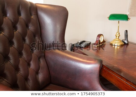 Arm chair with telephone, alarm clock and lamp on table Stock photo © wavebreak_media