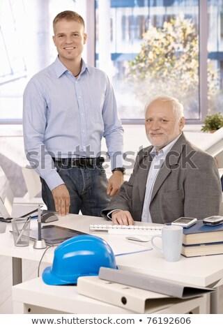 Starszy pracy działalności kobieta biuro człowiek Zdjęcia stock © IS2