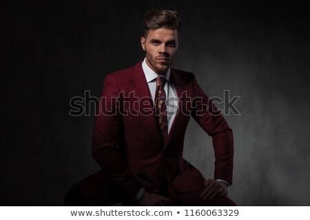 Genç gündelik adam el uyluk Stok fotoğraf © feedough
