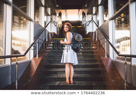 Woman climbing railway station stairs Stock photo © IS2