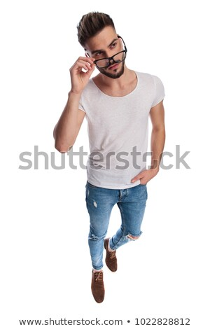 full body picture of a young casual man removing  eyeglasses  Stock photo © feedough