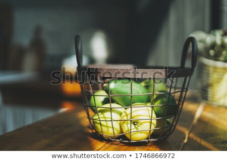 Fruit basket on a windowsill Stock photo © IS2