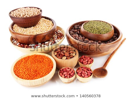 Lentils in wooden bowl isolated. Groats in wood dish. Grain on w Stock photo © MaryValery