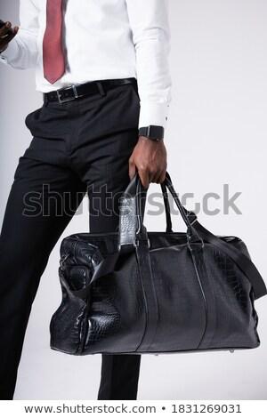Africano empresário couro mala negócio terno Foto stock © studioworkstock