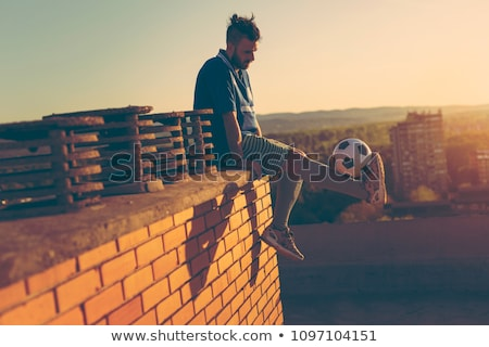 Soccer player with ball on rooftop Stock photo © IS2