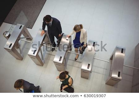 Stock photo: Businesspeople walking through corridor