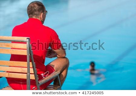férfi · ül · mosolyog · mosoly · portré · úszómedence - stock fotó © is2